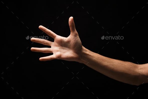 Taking hand isolated on black background - Stock Photo - Images