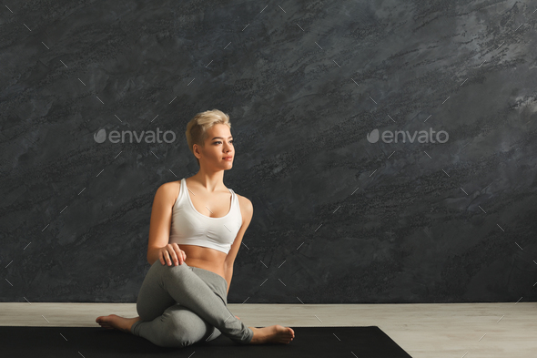 Woman having rest after training yoga in gym - Stock Photo - Images