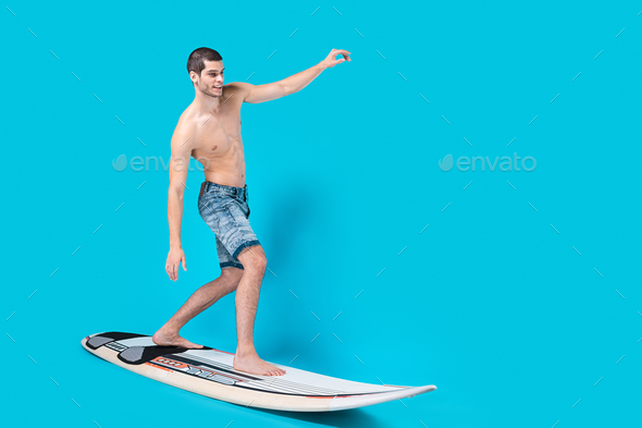 Surfer riding waves - Stock Photo - Images