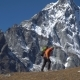 Man with Backpack Climb in the Mountains - VideoHive Item for Sale