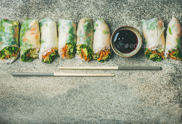 Flat-lay of vegan spring or summer rice paper rolls - Stock Photo - Images