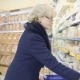 Woman Buys Milk in a Bottle in a Store - VideoHive Item for Sale