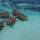 Drone flying over overwater bungalows in the Maldives - VideoHive Item for Sale