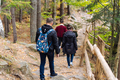 man and woman walking along hiking trail - PhotoDune Item for Sale