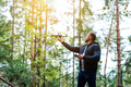 guy starts a quadrocopter in the forest - PhotoDune Item for Sale