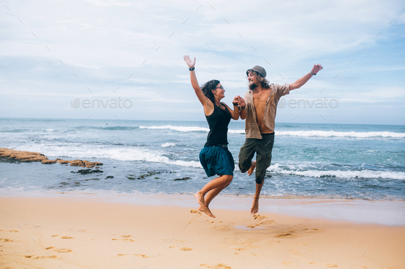 guy and girl have fun on the beach - Stock Photo - Images