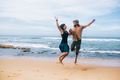 guy and girl have fun on the beach - PhotoDune Item for Sale