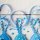Handmade patchwork blue felt easter eggs on white wooden table - PhotoDune Item for Sale
