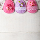 Handmade patchwork pink and lilac felt easter eggs on white wood - PhotoDune Item for Sale