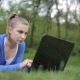 College Student Lying Down On The Grass Working On Laptop At Campus - VideoHive Item for Sale