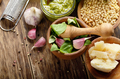 Top view of Pesto sauce ingredients and utensils on wood table - PhotoDune Item for Sale