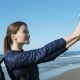 Beautiful Woman Taking Selfie with Smile on the Sea Coast - VideoHive Item for Sale