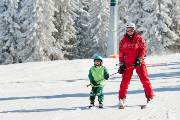 Ski instructor learning skiing - Stock Photo - Images