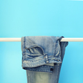 Close-up of blue jeans on a rack - PhotoDune Item for Sale
