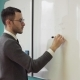 Man Teacher Writes on White Board in Class Room - VideoHive Item for Sale