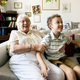 Grandma and grandson sitting on the sofa together - PhotoDune Item for Sale