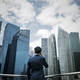 Asian businessman in a city - PhotoDune Item for Sale
