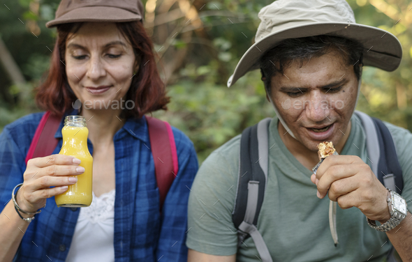 Couple having a break from trekking - Stock Photo - Images