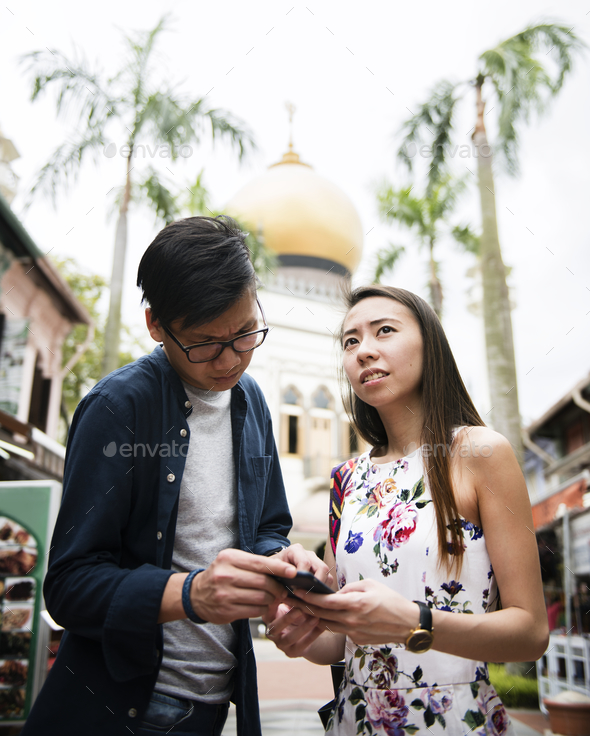 Asian couple dating - Stock Photo - Images