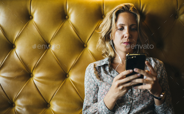 Woman using her phone - Stock Photo - Images