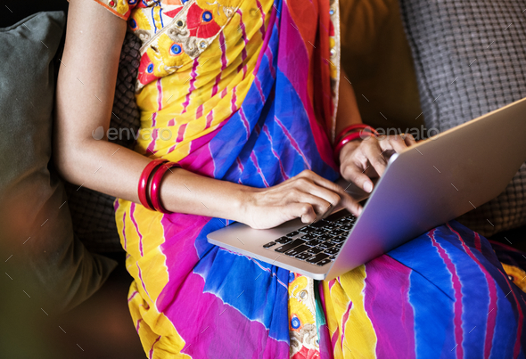 Indian woman is using computer laptop - Stock Photo - Images