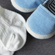 Baby shoes and sock on the floor - PhotoDune Item for Sale