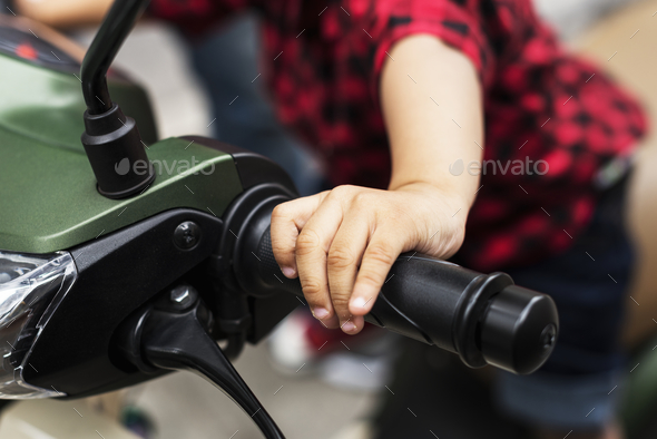 Young Indian boy riding the motobike - Stock Photo - Images