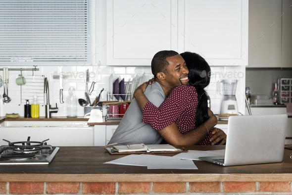 Black couple hugging together - Stock Photo - Images