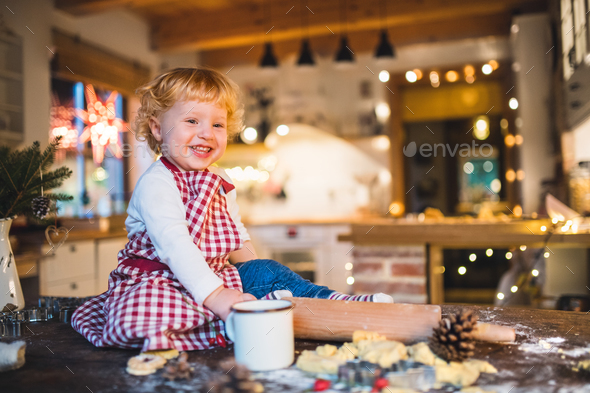 Toddler boy making gingerbread cookies at home. - Stock Photo - Images