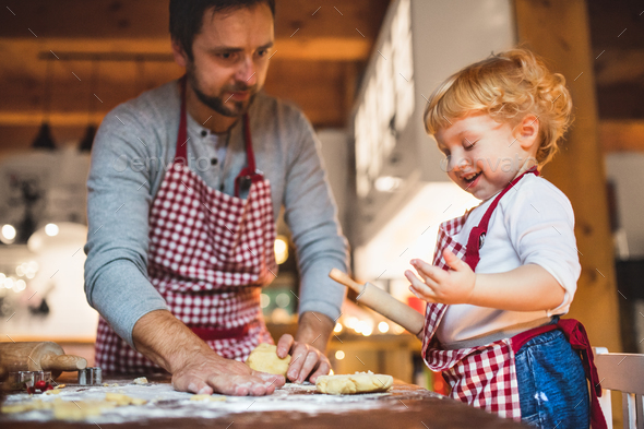 Young family making cookies at home. - Stock Photo - Images