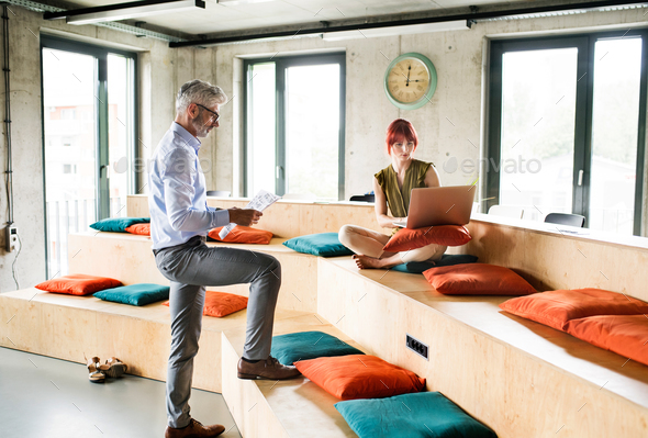 Business people in the office consulting a project. - Stock Photo - Images