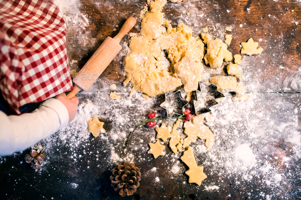 Toddler making gingerbread cookies at home. - Stock Photo - Images