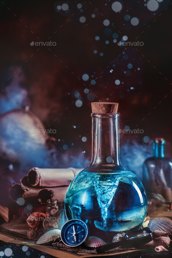 Marine scene with a tornado sealed in a laboratory flask, compass, seashells and water drops. - Stock Photo - Images