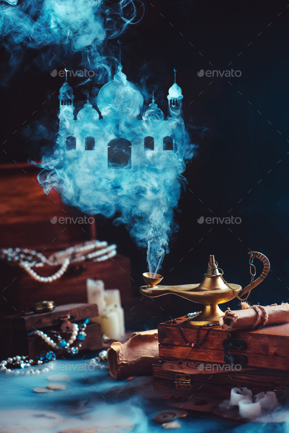 Magic lamp with mystic smoke forming an arabic castle, still life with treasure and jewelry. - Stock Photo - Images