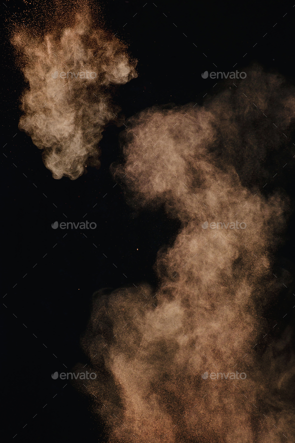 Cocoa powder explosion in motion. Chocolate dust on a black background. Action food photography. - Stock Photo - Images