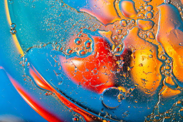 Abstract background of drops of liquid in red and blue tones - Stock Photo - Images