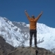 The Tourist Climbs the Cliff in the Himalayas - VideoHive Item for Sale