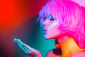 Fashion model woman in colorful bright lights with trendy make-u - PhotoDune Item for Sale