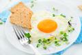Healthy breakfast. Fried heart shaped egg closeup - PhotoDune Item for Sale