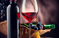 Wine. Bottle and glass of red wine with ripe grapes - PhotoDune Item for Sale