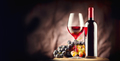 Wine. Bottle and glass of red wine with ripe grapes still life - PhotoDune Item for Sale