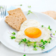 Healthy breakfast. Fried heart shaped egg closeup - PhotoDune Item for Sale