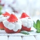 Christmas holiday dessert. Strawberry Santa stuffed with whipped - PhotoDune Item for Sale
