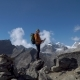 Man with a Backpack Travel in the Himalayan Mountains - VideoHive Item for Sale