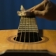 Guitarist Gently Rubs Strings of His Acoustic Guitar - VideoHive Item for Sale