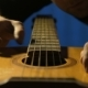 Craftsman Checks Sound of Old Acoustic Guitars and Touches of Strings - VideoHive Item for Sale