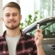 Attractive Young Man Smiling Holding Car Keys Posing at the Automotive Dealership - VideoHive Item for Sale