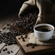 coffee cups and coffee beans on a wooden table - PhotoDune Item for Sale