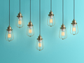 Seven vintage lamps hanging from the ceiling with blue wall 3D renderind - PhotoDune Item for Sale