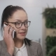 Young Businesswoman Talking on the Phone Indoors - VideoHive Item for Sale